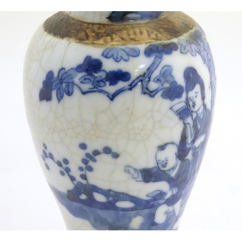 9 - A Chinese blue and white baluster vase depicting figures in a landscape, with incised banded border ...