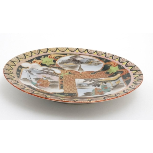 13 - A Japanese plate with panelled decoration depicting Geisha girl style figures in a Japanese landscap...