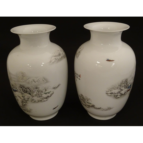 15 - A pair of Chinese baluster vases with flared rims, with transfer decoration depicting winter landsca...