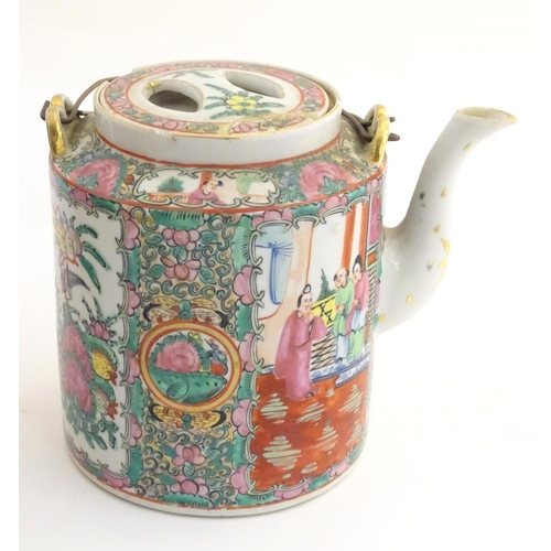 20 - A Chinese Cantonese teapot and cover with famille rose decoration with panelled decoration depicting...