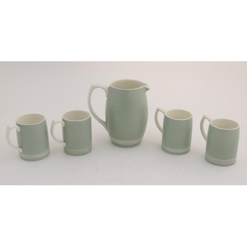 50 - A mid 20thC Keith Murray Wedgwood lemonade / beer set, comprising a moonstone jug and four tankards,...