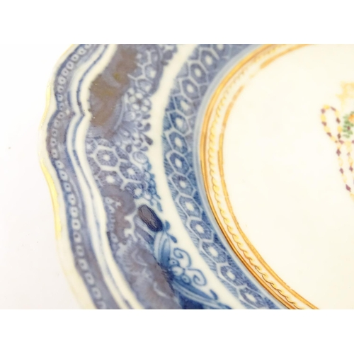 24 - An 18th / 19thC Chinese export blue and white porcelain saucer with blue Fitzhugh borders with flowe...