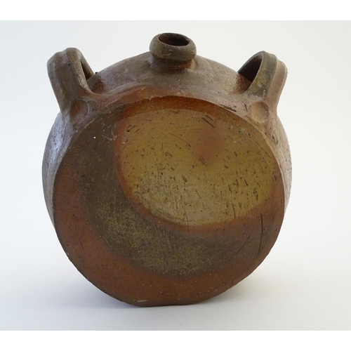 31 - A studio pottery drinking vessel formed as a flattened amphora of the Middle Ages, of circular form ...