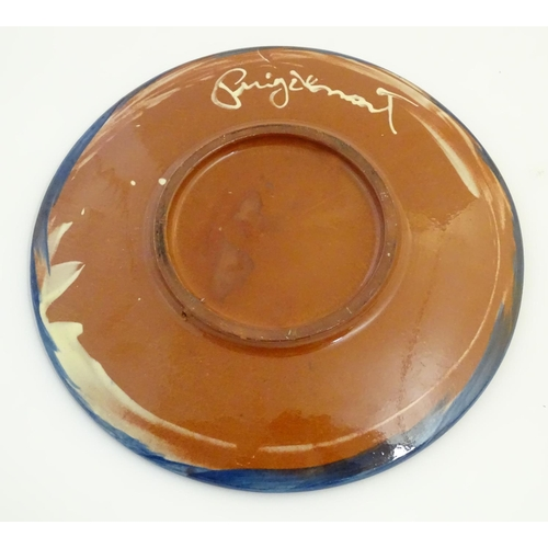 41 - A Spanish Puigdemont majolica slipware plate / charger with fish and coral decoration. Signed under....