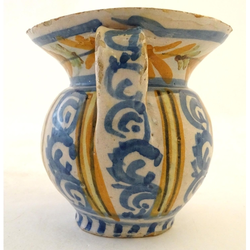 47 - A 19thC Continental faience / tin glaze jug with a pinch spout, decorated with a roundel inscribed B...