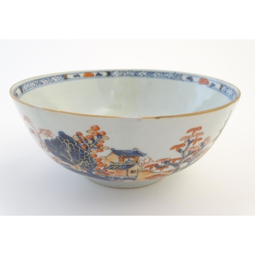 5 - An oriental bowl decorated with landscape scenes and figures in the Imari palette. Approx. 3 1/4