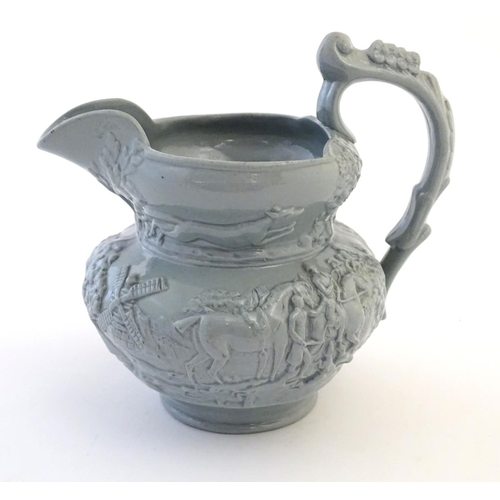 52 - A 19thC relief moulded jug depicting hunting scenes, with figures on horseback in a landscape, a win...