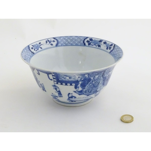 5 - A Chinese blue and white footed bowl with a flared rim, decorated with a scene depicting the enterta...