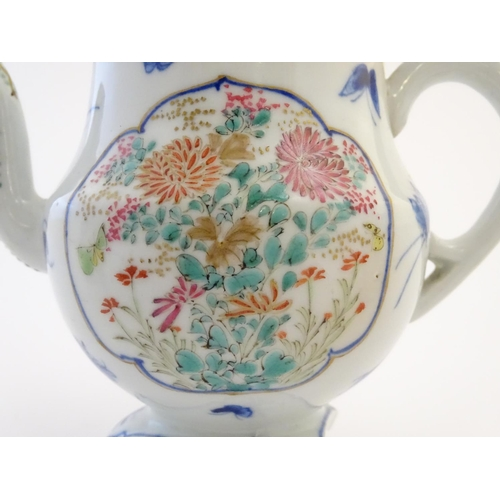 18 - A Japanese teapot, twin handled sugar bowl and milk jug decorated with hand painted insects and pane...