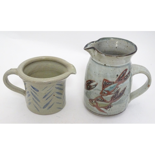 38 - Two studio pottery jugs, one with stylised fish decoration, the other with brushwork chevron detail....