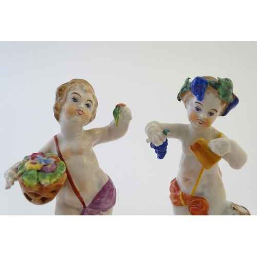 45 - Two Italian putti / cherub figures depicting the seasons Spring and Summer, one with a basket of flo...