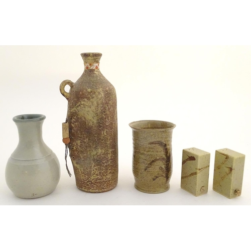 51 - A quantity of assorted studio pottery wares, to include vases, a salt and pepper of rectangular form...