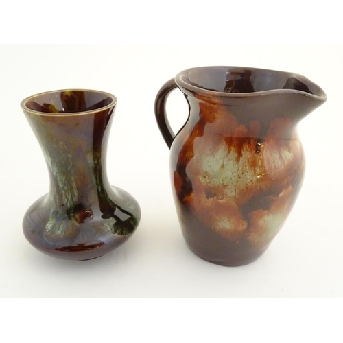 52 - A Welsh Ewenny studio pottery earthenware jug with a mottled glaze. Marked under. Together with a st...