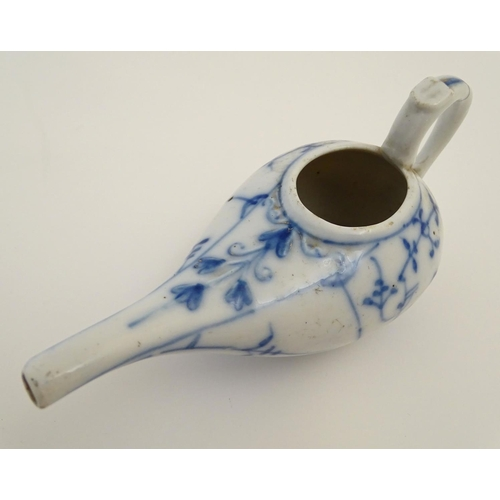 10 - A blue and white pap boat with a stylised floral and foliate design with a handle and spout. Marked ...