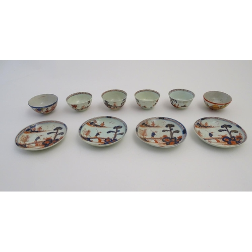 14 - Four Oriental tea bowls and saucers in the Imari palette, decorated with a landscape scene with an e...
