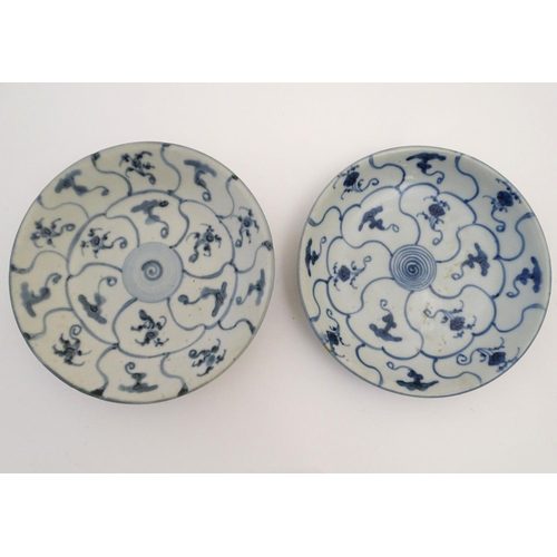 16 - Two Chinese blue and white Tek Sing plates with central roundels with radiating cells decorated with...