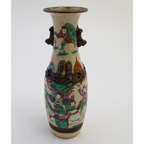 2 - A Chinese crackle glaze vase with twin handles formed as stylised animals, and stylised bixies to th...