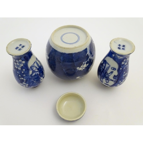 22 - A Chinese blue and white ginger jar decorated with cherry blossom, together with a pair of small bal...