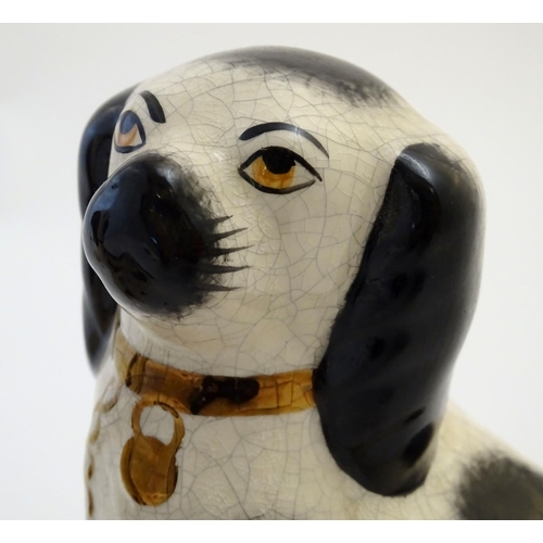 26 - A pair of Staffordshire Ware Kent dogs, formed as spaniels, with gilt highlights. Marked under. Appr...