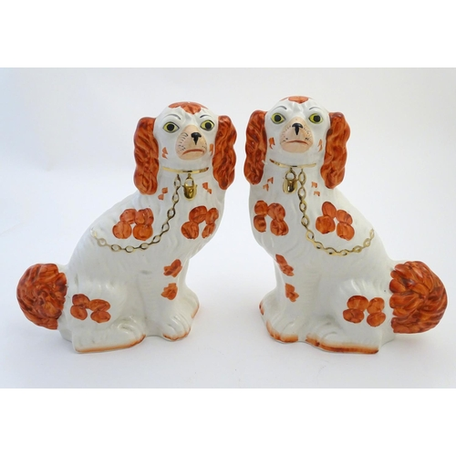 27 - Two pairs of Staffordshire mantel dogs by Arthur Wood, one pair black and white, the other pair red ...
