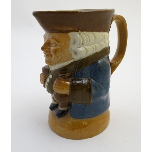 31 - A Royal Doulton Lambeth stoneware Toby character jug, The Standing Man, wearing a brown hat and wais...