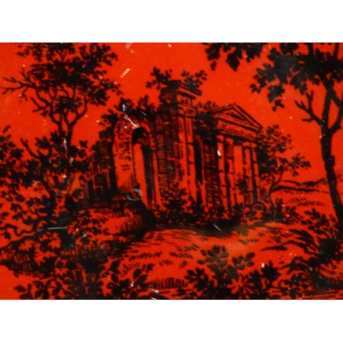 35 - A Royal Doulton flambe dish depicting a wooded landscape with a classical ruin. Marked under Woodcut...