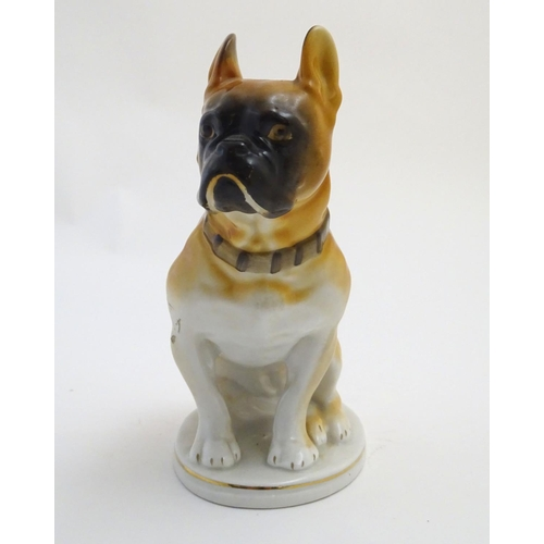 36 - A Russian Lomonosov figure of a seated Mastiff dog on an oval base. Marked Made in USSR with maker's...