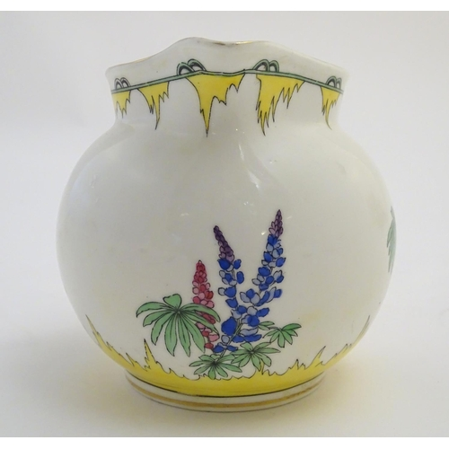 40 - An Art Deco Adderleys jug in the pattern Lupin, with stylised flower decoration. Marked under Exclus...