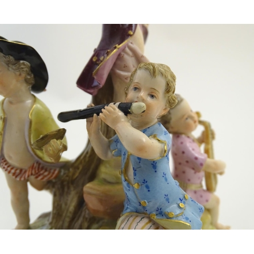 41 - A 19thC Meissen porcelain figure group depicting five putti / children playing musical instruments o...
