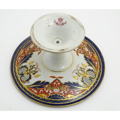 59 - An Ashworth Bros tazza in the Imari palette with floral decoration with gilt highlights. Marked unde...