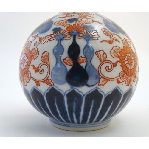 6 - An Oriental globular vase in the Imari palette with an elongated neck with a flared rim, decorated w...