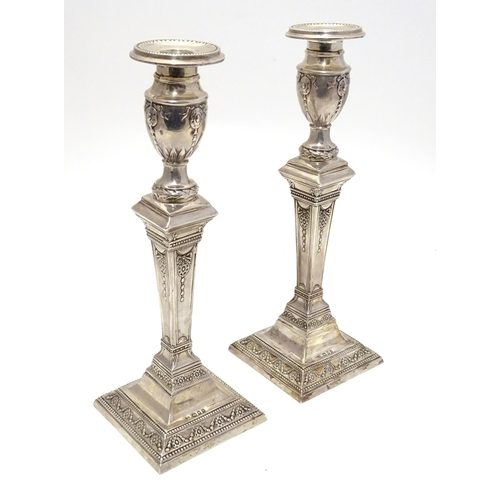 367 - A pair of silver candlesticks hallmarked London 1931, maker Charles Kirkham. Approx. 11
