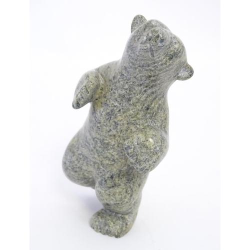 822 - A 20thC Inuit serpentine carving depicting a dancing bear by Markosie Papigatok (b. 1976) (Cape Dors...