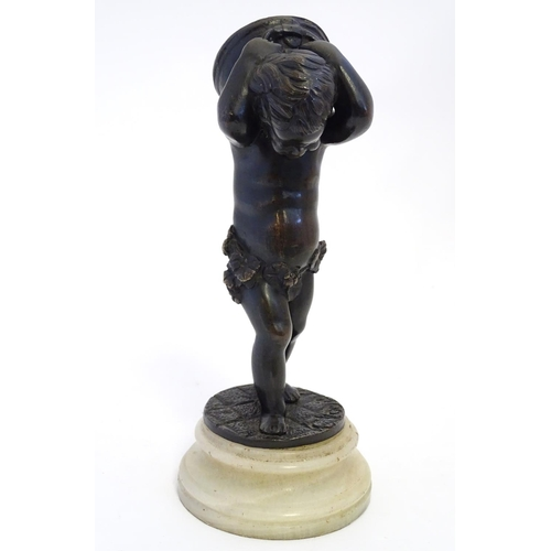 823 - A bronze sculpture after Claude Michel (1738-1814) depicting a boy / putto carrying a twin handled p...