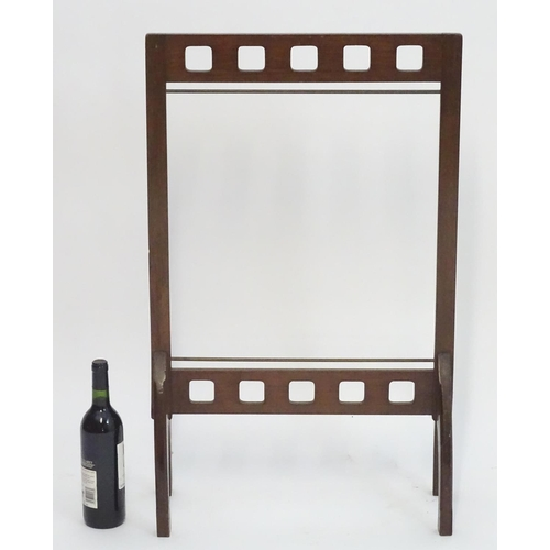 899 - A late 19thC / early 20thC mahogany fire screen frame. In the Glasgow school style. 21