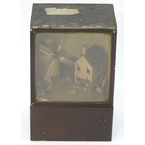 900 - A Victorian diorama display depicting a naive  scratch built scene of a windmill and cottage within ...