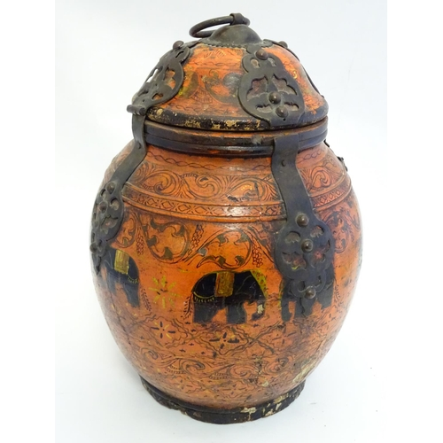 901 - A late 19th / early 20thC carved wooden container / pot and cover with polychrome decoration depicti...
