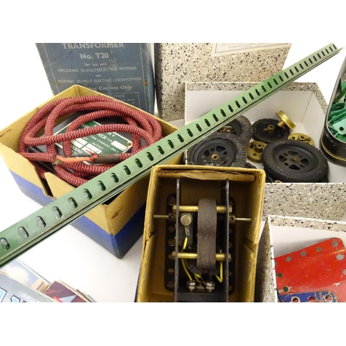 830 - Toys: A quantity of Meccano, to include, wheels, nuts, bolts, screws, washer, axles, plates, gears, ...