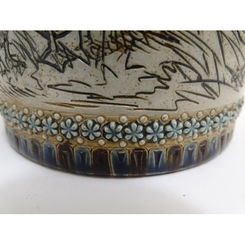 57 - A Doulton Lambeth Hannah Barlow stoneware biscuit barrel of cylindrical form with incised sgraffito ...