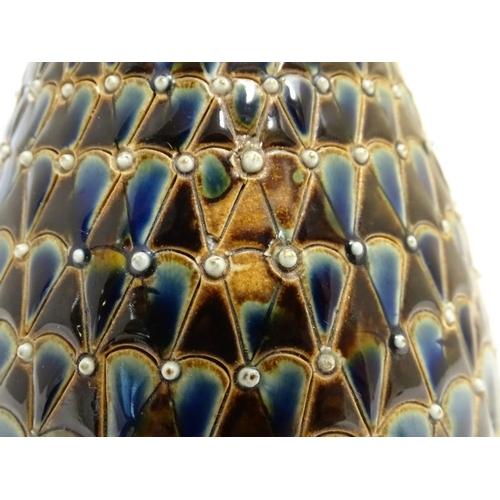 58 - A Doulton Lambeth stoneware jug / ewer with relief decoration. Impressed marks under, maker HW etc. ...