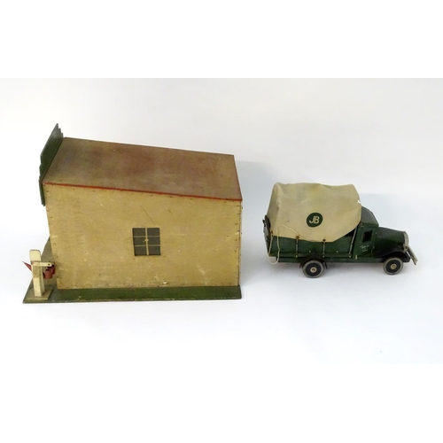 829 - Toy: A WW2 (World War Two) era scratch built model of Art Deco garage, the tiled flat sloping roof m...