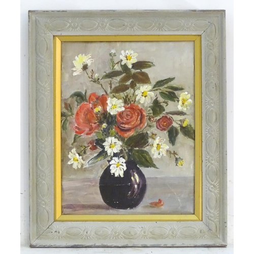 """Manner of Marcel Dyf (1899-1985), Oil on canvas, A still life study of flowers, red roses and dog roses, in a vase. Ascribed to canvas verso: Marcel Dyf French 20thC, (Dyf indistinct). Approx. 13 1/2"""" x 11 3/4""""   The painting was acquired in a market in Brittany in 2019, Marcel Dyf had a Summer home there in Arzon, France."""