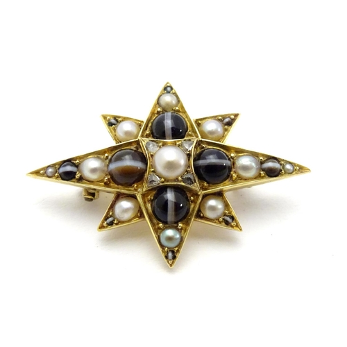 "A yellow metal brooch of star form set with banded agate, rose-cut diamonds and half pearls. 1 1/4"" high"