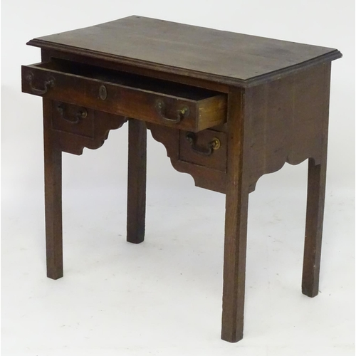 1193 - An 18thC oak lowboy with a moulded rectangular top above a single long and two short false drawers w...