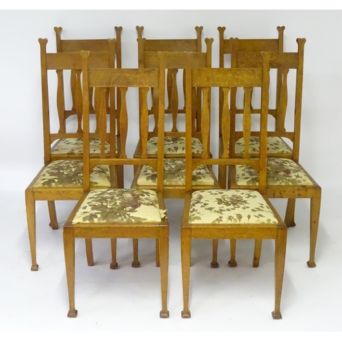 1194 - A set of eight oak Arts & Crafts dining chairs by Hampton and Sons, Pall Male, London. Having straig...