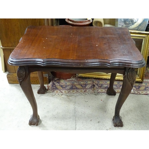 17 - Side table with serpentine top and ball and claw feet. Approx. 38