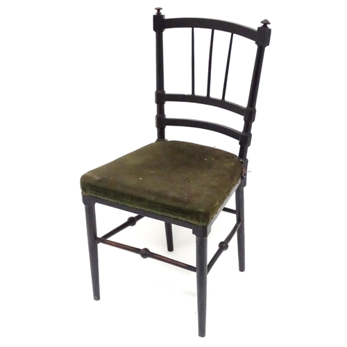 22 - An early 20thC small ebonised bedroom chair with a velvet upholstered seat. Approx. 32 1/2