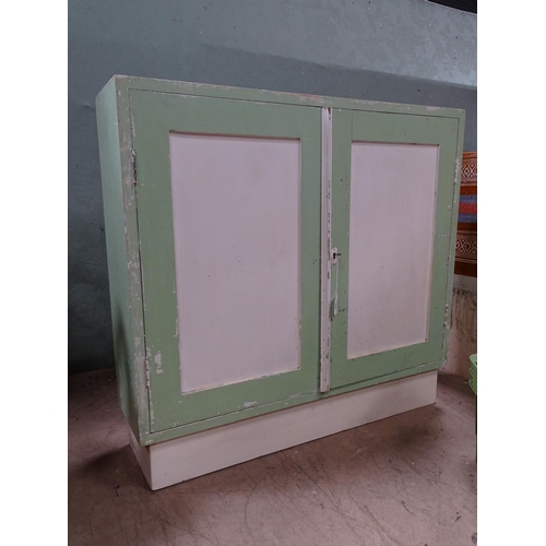 34 - An early 20thC painted 2-door cupboard. Approx. 30