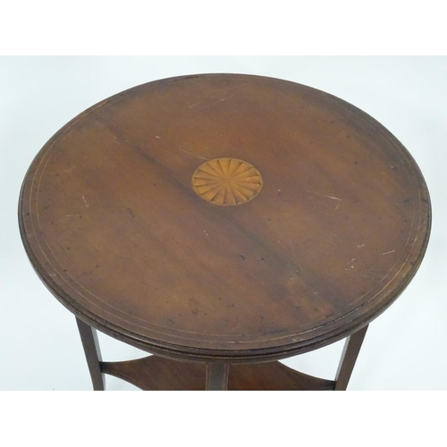 45 - A small circular inlaid table. Approx. 27 1/2