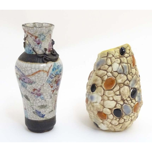 23 - An asymmetrical Sylvac vase with pebble decoration. Impressed marks to base. Approx. 6 1/2'' high. T...